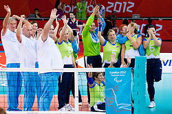 Adolf Urnaut, assistant coach of Slovenia, Matej Kovac, Simon Bozic, head coach of Slovenia, Danica Gosnak of Slovenia, , Regina Terbuc Roudi of Slovenia, Bogomira Jakin of Slovenia, Marinka Cencelj of Slovenia, Alenka Irsic of Slovenia, Anita Goltnik Urnaut of Slovenia, Suzana Ocepek of Slovenia  celebrate after winning the 5th - 8th place sitting volleyball match between National teams of Slovenia and Japan during Day 7 of the Summer Paralympic Games London 2012 on September 4, 2012, in ExCel Exhibition centre, London, Great Britain. Slovenia defeated Japan 3-0. (Photo by Vid Ponikvar / Sportida.com)