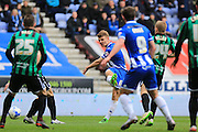 Max Power shoots during the Sky Bet League 1 match between Wigan Athletic and Rochdale at the DW Stadium, Wigan, England on 28 March 2016. Photo by Daniel Youngs.