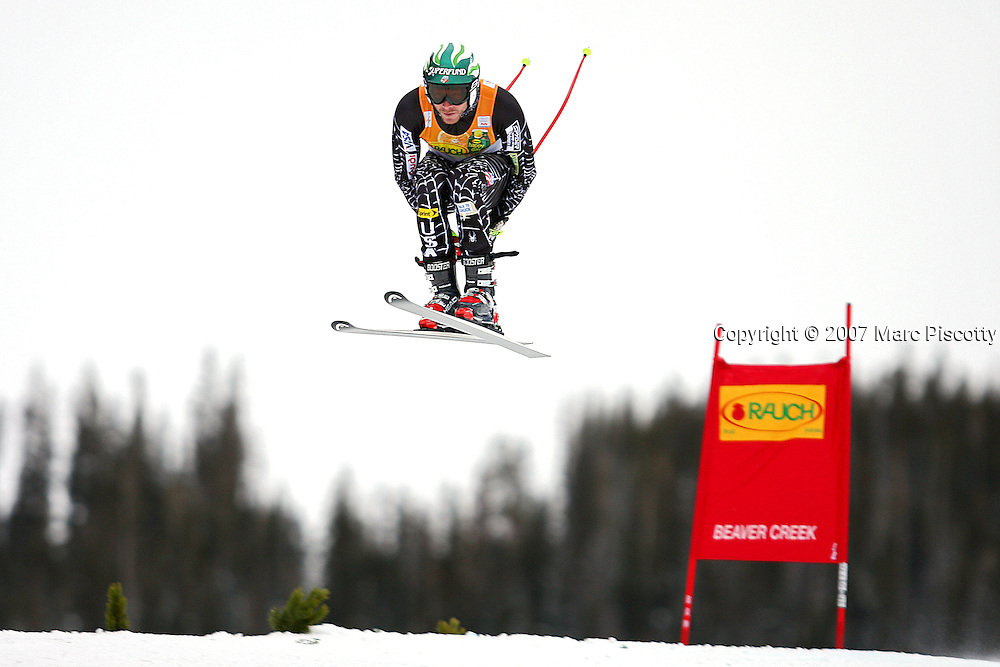 SHOT 11/29/2007 - U.S. skier Bode Miller catches air off the Red Tail jump during the downhill run of the Men's Super Combined at the 2007/08 Charles Schwab Birds of Prey ski race in Beaver Creek, Co. The event was won by Swiss skier Daniel Albrecht (2:00.26) with French skier Jean-Baptiste Grange finishing second (2:00.93) and Czech skier Ondrej Bank finishing third ((2:01.23). US skier Bode Miller finished just out of the medals in fourth (2:01.28) and Ted Ligety finished eighth (2:01.67). Thomas (TJ) Lanning finished tenth (2:01.89). Miller, always a controversial figure in skiing, quit the U.S. Ski Team in the offseason to race on his own. Miller didn't place in the top three in any of the events in Beaver Creek this year..(Photo by Marc Piscotty/ © 2007)
