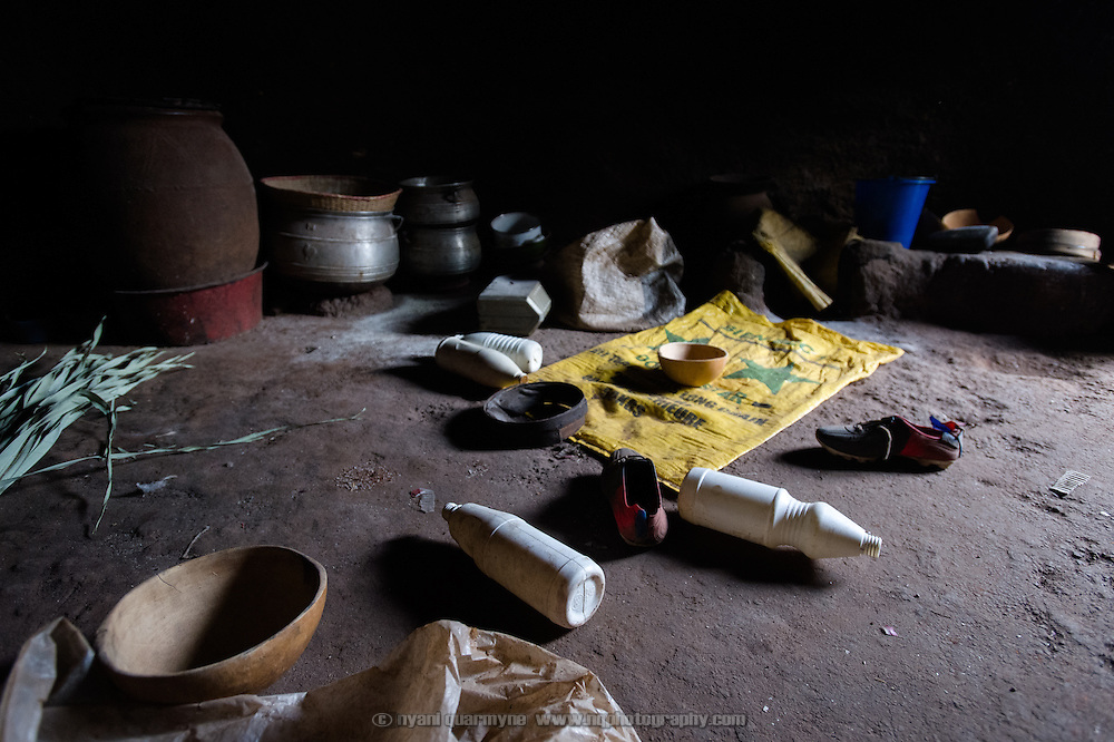Food preparation and storage utensils on the floor of a hut that is used as a food preparation area at a homestead belonging to the Barro extended family in the village of Toussiana in the Hauts-Bassins region of Burkina Faso, on 22 February 2016.