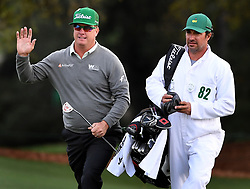 April 6, 2017 - Augusta, GA, USA - Charley Hoffman, left, acknowledges the applause of the gallery as he and his caddie, Brett Waldman, right, arrive at the 18th green during first-round action of the Masters Tournament at Augusta National Golf Club on Thursday, April 6, 2017, in Augusta, Ga. Hoffman finished the round at -7. (Credit Image: © Jeff Siner/TNS via ZUMA Wire)
