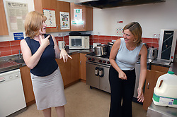Woman in the kitchen using sign language,