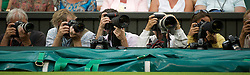 28.06.2011, Wimbledon, London, GBR, WTA Tour, Wimbledon Tennis Championships, im Bild Photographers in action during the Ladies' Singles Quarter-Final match on day eight of the Wimbledon Lawn Tennis Championships at the All England Lawn Tennis and Croquet Club. EXPA Pictures © 2011, PhotoCredit: EXPA/ Propaganda/ David Rawcliffe +++++ ATTENTION - OUT OF ENGLAND/UK +++++ // SPORTIDA PHOTO AGENCY