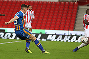 13 James Bolton shoots and scores for Shrewsbury Town  during the The FA Cup 3rd round replay match between Stoke City and Shrewsbury Town at the Bet365 Stadium, Stoke-on-Trent, England on 15 January 2019.