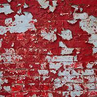 Peeling paint reveals old paint, mortar, and original brick on the weathered wall of the Assateague Light House (rebuilt 1866), Chincoteague National Wildlife Refuge, Assateague Island, Virginia.