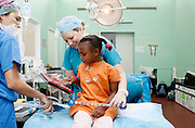 No. 74, Sidonie Haritiana, UCL, unilateral Cleft lip, female, 7 years old, <br /> before, on the operating table with Child life specialist Joy Daugherty .<br /> <br /> Operation Smile South Africa<br /> Operation Smile Mission to Hospital Joseph Ravoanangy Andrianavalona,<br /> Antananarivo, Madagascar. September 17th - 29th 2011<br /> <br /> &copy; Operation Smile Photo / Zute &amp; Demelza Lightfoot<br /> www.lightfootphoto.com