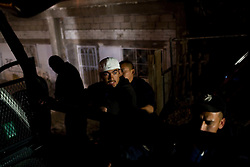 Police in Ciudad Juarez, Mexico search a man during a nighttime security sweep.  Mexico is undergoing a violent war with the nation's drug cartels and Ciudad Juarez has become the murder capital of Mexico, with over 4,000 murders in the past two years.  President Felipe Calderon has dispatched thousands of soldiers and federal police officers in order to contain the situation, but they have not been successful.