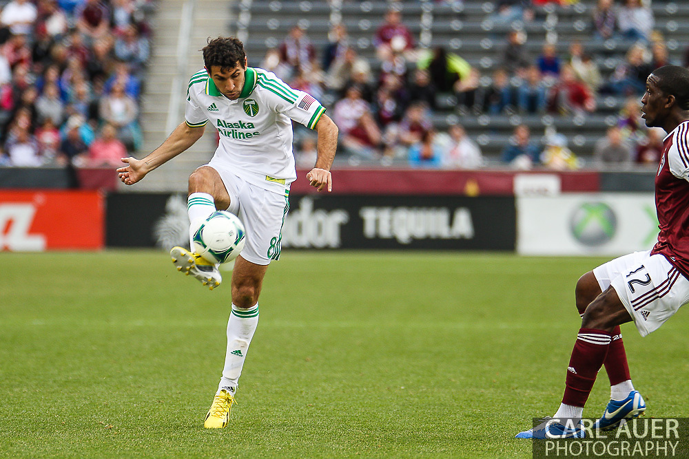 March 30th, 2013 Commerce City, CO - Portland Timbers midfielder Diego Valeri (8) attempts to cross the ball in front of the Rapids goal in the first half of the MLS match between the Portland Timbers and the Colorado Rapids at Dick's Sporting Goods Park in Commerce City, CO