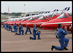 Image licensed to i-Images Picture Agency. 11/07/2014. Windsor, United Kingdom. The  Red Arrows prepare as they put on display as part of their 50th anniversary display season at the Royal International Air Tattoo at RAF Fairford, Gloucestershire,  United Kingdom. Picture by Stephen Lock / i-Images