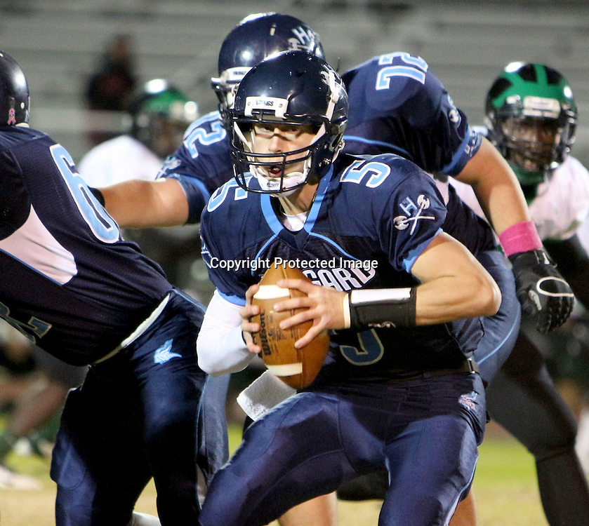 Hoggard's Austin Schoenleber looks too pass against West Brunswick Monday night at Hoggard High School. (Jason A. Frizzelle)