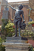 Bronze statue of young David holding Goliath's head by Giuseppe Bumi at Novara di Sicilia, province of Messina Sicily, Italy July 2006