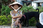Rach Gia. Woman caressing her dog.