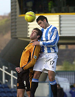 Photo. Glyn Thomas.<br /> Huddersfield Town v Hull City. Nationwide Division 3.<br /> The Alfred McAlpine Stadium, Huddersfield. 15/11/03.<br /> Huddersfield's Paul Scott (R) fights an aerial battle for possession with Ben Burgess.