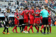 Referee Martin Atkinson marches the Huddersfield Town wall back ten yards at a free kick during the Premier League match between Newcastle United and Huddersfield Town at St. James's Park, Newcastle, England on 31 March 2018. Picture by Craig Doyle.