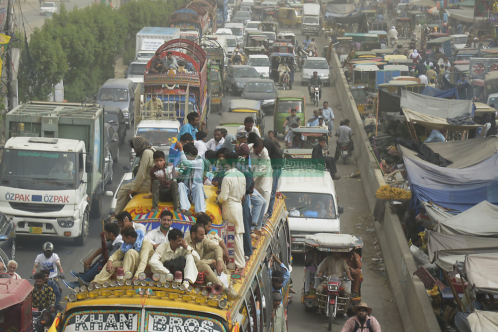 June 14, 2018 - Lahore, Punjab, Pakistan - Pakistani people ride on a crowded bus to reach their villages and cities to celebrate the Muslim holiday festival Eid al-Fitr. Muslims around the world are preparing to celebrate the Eid al-Fitr, which marks the end of the fasting month of Ramadan. (Credit Image: © Rana Sajid Hussain/Pacific Press via ZUMA Wire)