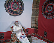 In Torajan culture, death is not necessarily the end.  The body of Lai' Tiku who passed on a few months ago is seen in a  seated position in her home, which signifies her high caste in the social ladder.  The matriarch in her family, Nenek Lai' Tiku passed away at age 102, she is survived by 10 children, 49 grandchildren, and 162 great-grandchildren.