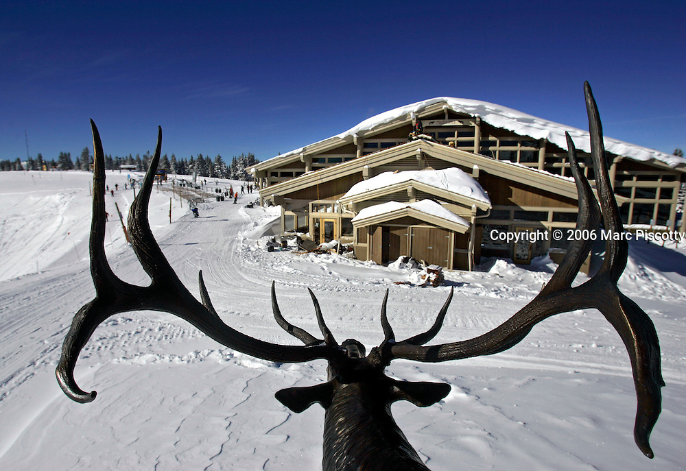 "A view of Two Elk Lodge and part of China Bowl looking through the antlers of an elk statue that stands beside the lodge on Thursday December 15, 2005. The lodge is located in the back bowls of Vail Ski Resort and is adding an addition that should increase seating by about 200 or more seats. The lodge was burnt to the ground in 1998 in an apparent act of ecoterrorism. The fires damaged or destroyed four buildings including Two Elk Lodge, the ski patrol headquarters, and four lifts at the top of the mountain. A new lodge was built on the site and opened in 2000 and the fire remains one of the nation's costliest ecoterrorism incidents. Federal prosecutors have identified 28-year-old Chelsea Dawn Gerlach, known to investigators as ""Country Girl,""  as a prime suspect in the 1998 Vail arsons that caused $12 million in damages..(MARC PISCOTTY/ © 2005)"