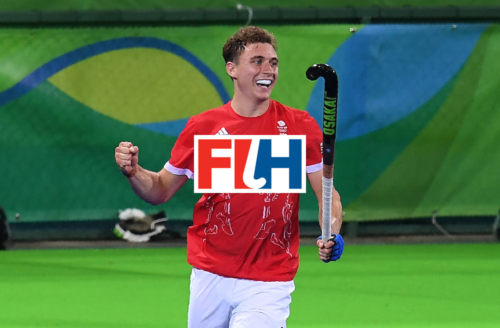 Britain's Harry Martin celebrates scoring a goal during the men's field hockey Brazil vs Britain match of the Rio 2016 Olympics Games at the Olympic Hockey Centre in Rio de Janeiro on August, 9 2016. / AFP / MANAN VATSYAYANA        (Photo credit should read MANAN VATSYAYANA/AFP/Getty Images)