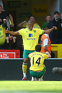 Picture by Paul Chesterton/Focus Images Ltd.  07904 640267.11/03/12.Wes Hoolahan of Norwich scores his sides 1st goal and celebrates during the Barclays Premier League match at Carrow Road Stadium, Norwich.