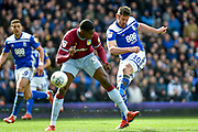 Birmingham City striker Lukas Jutkiewicz (10) takes a shot at goal through the legs of Aston Villa defender (on loan from Wolverhampton Wanderers) Kortney Hause (30) during the EFL Sky Bet Championship match between Birmingham City and Aston Villa at St Andrews, Birmingham, England on 10 March 2019.
