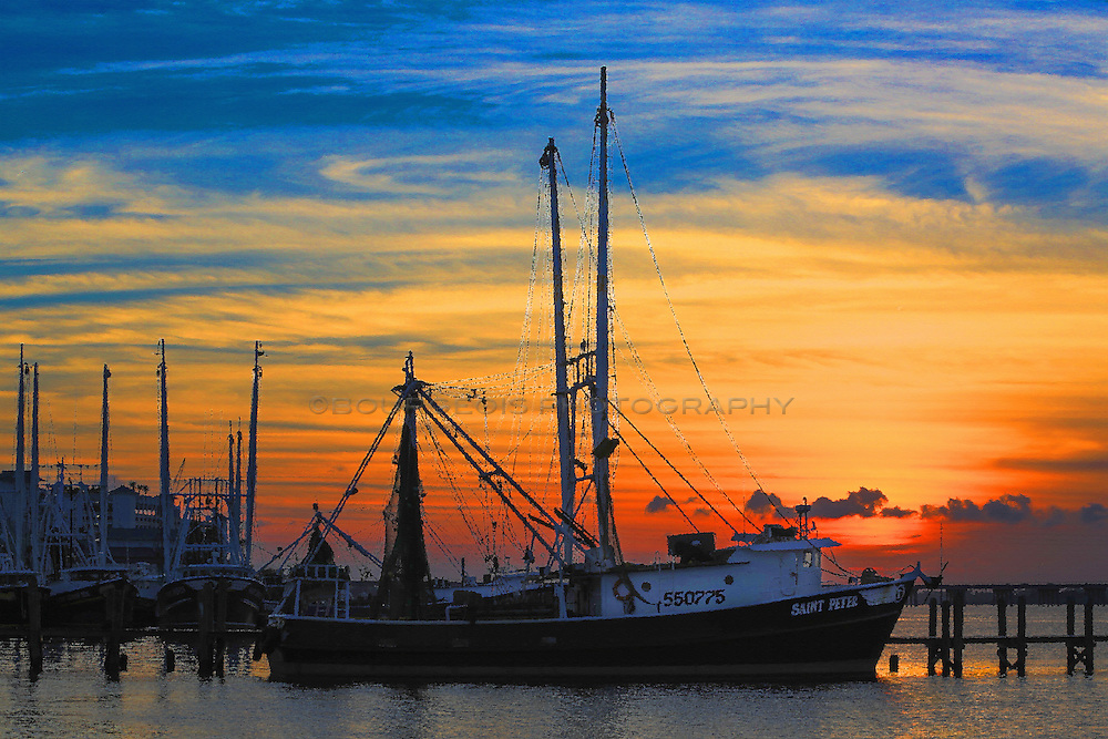 oil painting as a photo of shrimp boats at sunset