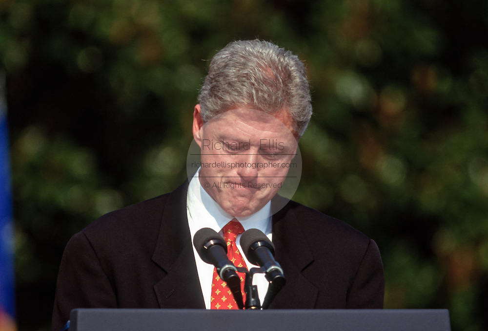 US President Bill Clinton looks down while welcomes Czech President Vaclav Havel at the White House during the Czech State Visit September 16, 1998 in Washington, DC.