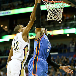 Feb 25, 2016; New Orleans, LA, USA; New Orleans Pelicans center Alexis Ajinca (42) blocks a shot by Oklahoma City Thunder guard Randy Foye (6) during the second quarter of a game at Smoothie King Center. Mandatory Credit: Derick E. Hingle-USA TODAY Sports
