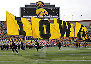 October 26 2013: The Iowa Hawkeyes take the field before the start of the NCAA football game between the Northwestern Wildcats and the Iowa Hawkeyes at Kinnick Stadium in Iowa City, Iowa on October 26, 2013. Iowa defeated Northwestern 17-10 in overtime.