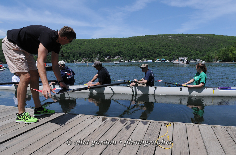GREENWOOD LAKE, NY.  Rowers push off from the dock prior to their race during the 2014 Greenwood Lake Challenge Regatta in Greenwood Lake, NY on Sunday, June 1, 2014. The annual event for novice rowers is a fundraiser for the East Arm Rowing Club in Greenwood Lake.  © Chet Gordon/THE IMAGE WORKS