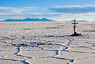 Crosses mark where people died in a head-on collision that killed a driver and some tourists in the Salar de Uyuni, Bolivia