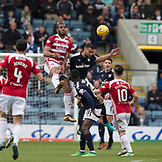 5th May 2018, Dens Park, Dundee, Scotland; Scottish Premier League football, Dundee versus Hamilton Academical; Steven Caulker of Dundee heads clear from Marios Ogboe of Hamilton Academical