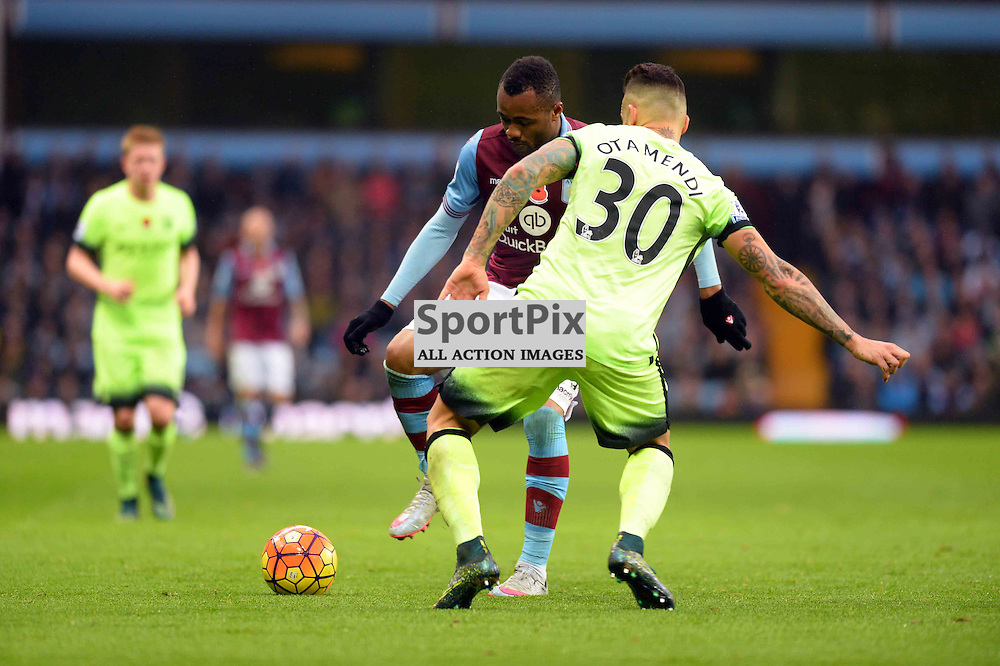 Jordan Ayew and Nicolas Otamendi stick a leg and arm out as they challenge for the ball
