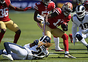 Los Angeles Rams cornerback Troy Hill (20) tackles San Francisco 49ers wide receiver Richie James (13) during an NFL football game, Sunday, Oct. 13, 2019, in Los Angeles. The 49ers defeated the Rams 20-7. (Dylan Stewart/Image of Sport)