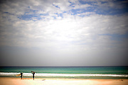 Surfers at Beit Yanai beach on a winter day. Nov 2011