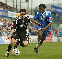 Photo: Aidan Ellis.<br /> Oldham Athletic v Swansea City. Coca Cola League 1. 22/04/2006.<br /> Swansea's Leon Britton takes on Oldham's Chris Taylor