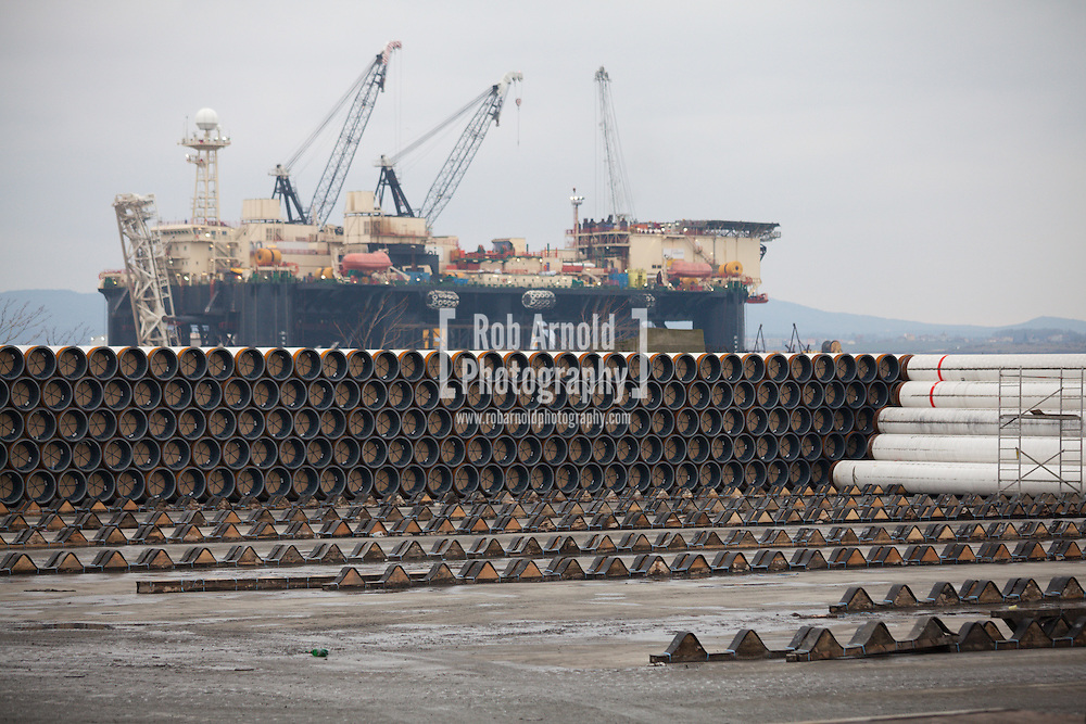 Piles of gas pipe, destined for the abandoned South Stream gas pipeline, in the port of Burgas, Bulgaria. Castoro Sei, one of Saipem's pipe lay barges is seen in the distance. Photo by Rob Arnold
