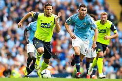 Ramadan Sobhi of Huddersfield Town goes past Aymeric Laporte of Manchester City  - Mandatory by-line: Robbie Stephenson/JMP - 19/08/2018 - FOOTBALL - Etihad Stadium - Manchester, England - Manchester City v Huddersfield Town - Premier League