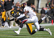September 22 2012: Iowa Hawkeyes wide receiver Keenan Davis (6) pulls in a pass as Central Michigan Chippewas defensive back Taylor Bradley (3) defends during the first half of the NCAA football game between the Central Michigan Chippewas and the Iowa Hawkeyes at Kinnick Stadium in Iowa City, Iowa on Saturday September 22, 2012. Central Michigan defeated Iowa 32-31.