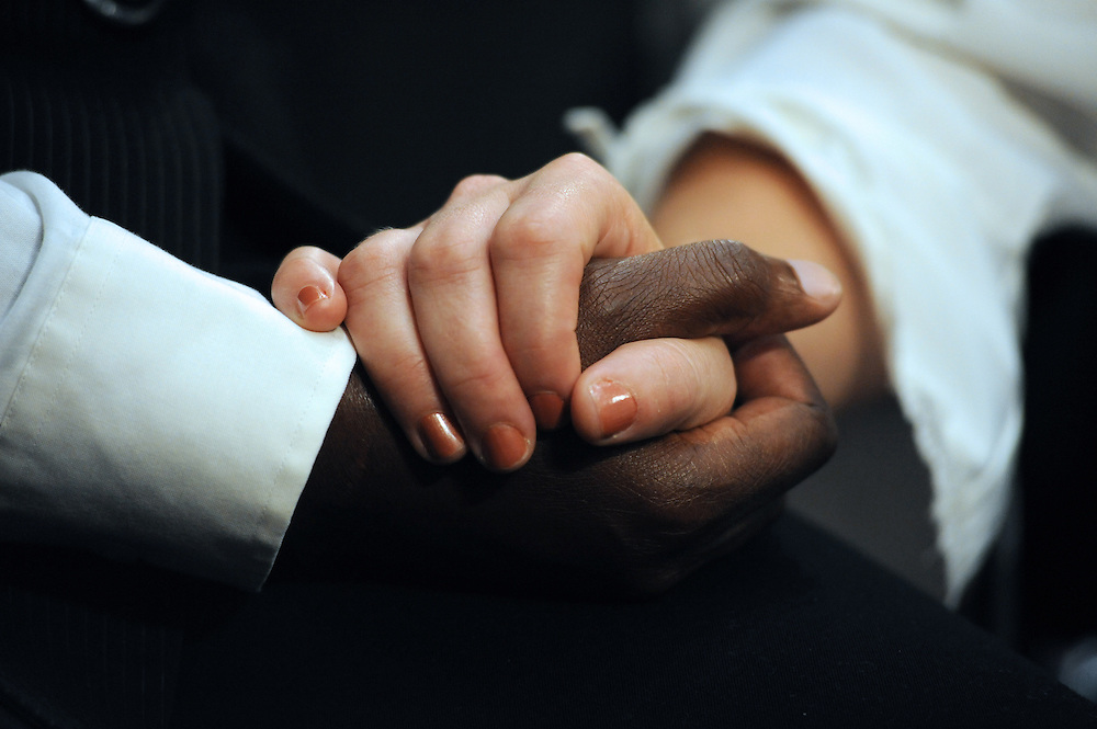 "Geraldine and Suzanne Artis, of Clinton, Conn., hold hands during a hearing entitled ""S.598, The Respect for Marriage Act: Assessing the Impact of DOMA on American Families."" Solmonese is among the witnesses to testify in the hearing. The Artis' have been together for 17 years and have three sons."