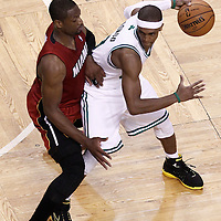 07 June 2012: Boston Celtics point guard Rajon Rondo (9) looks to pass the ball past Miami Heat shooting guard Dwyane Wade (3) during first half of Game 6 of the Eastern Conference Finals playoff series, Heat at Celtics at the TD Banknorth Garden, Boston, Massachusetts, USA.