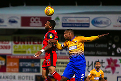 Wes Thomas of Grimsby Town and Krystian Pearce of Mansfield Town jump to head the ball - Mandatory by-line: Ryan Crockett/JMP - 06/11/2018 - FOOTBALL - One Call Stadium - Mansfield, England - Mansfield Town v Grimsby Town - Sky Bet League Two