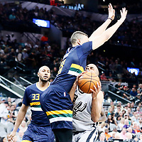 02 April 2017: Utah Jazz guard Dante Exum (11) defends on San Antonio Spurs guard Tony Parker (9) during the San Antonio Spurs 109-103 victory over the Utah Jazz, at the AT&T Center, San Antonio, Texas, USA.