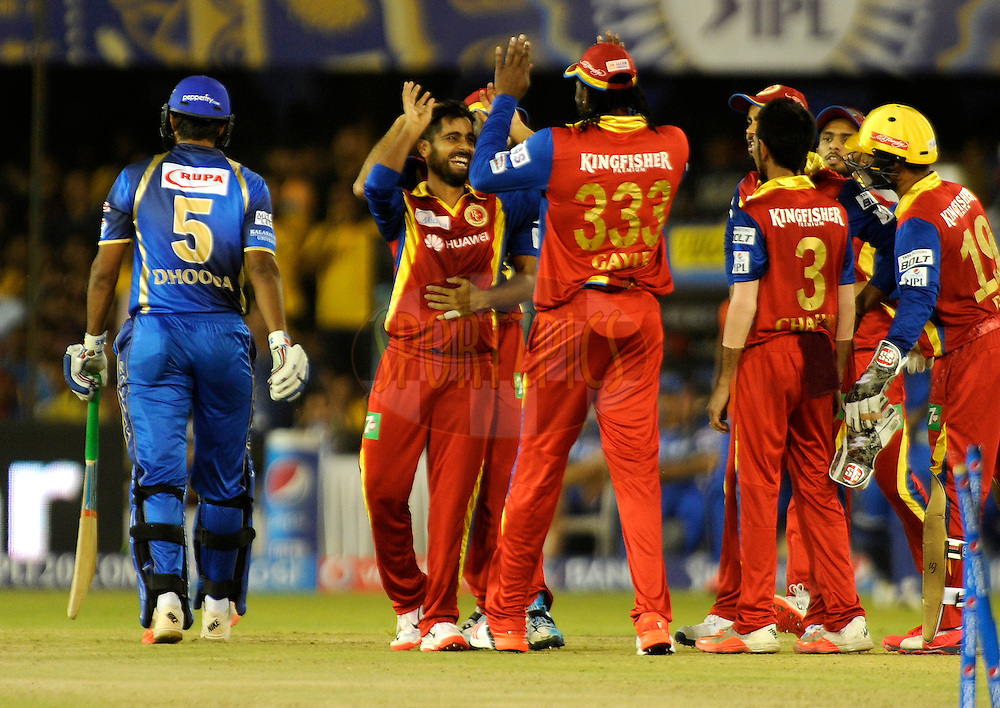 Iqbal Abdullah of Royal Challengers Bangalore celebrates the wicket of Deepak Hooda of Rajasthan Royals during match 22 of the Pepsi IPL 2015 (Indian Premier League) between The Rajasthan Royals and The Royal Challengers Bangalore held at the Sardar Patel Stadium in Ahmedabad , India on the 24th April 2015.<br /> <br /> Photo by:  Pal Pillai / SPORTZPICS / IPL