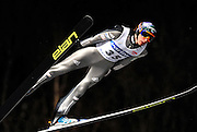 Denis Kornilov of Russia soars through the night skies during the FIS World Cup Ski Jumping in Sapporo, northern Japan in February, 2008.