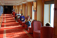 Relaxing with a book and a sea view - travellers on the Queen Mary 2 travelling from New York, USA, Southampton, UK. 201110274501..Copyright Image from Victor Patterson, 54 Dorchester Park, Belfast, United Kingdom, UK...For my Terms and Conditions of Use go to http://www.victorpatterson.com/Victor_Patterson/Terms_%26_Conditions.html