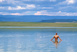 naked man alone in a beautiful lake in New Mexico