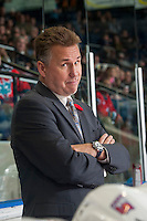 KELOWNA, CANADA - NOVEMBER 7: Don Nachbaur, head coach of the Spokane Chiefs hams it up for the camera against the Kelowna Rockets on November 7, 2014 at Prospera Place in Kelowna, British Columbia, Canada.  (Photo by Marissa Baecker/Shoot the Breeze)  *** Local Caption *** Don Nachbaur;