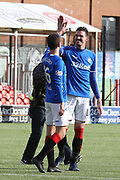 Rangers forward Kyle Lafferty (11) and Rangers midfielder Andrew Halliday (16) celebrate winning after the Ladbrokes Scottish Premiership match between Hamilton Academical FC and Rangers at New Douglas Park, Hamilton, Scotland on 24 February 2019.