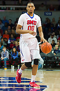 DALLAS, TX - DECEMBER 29: Ben Moore #00 of the SMU Mustangs brings the ball up court against the Midwestern State Mustangs on December 29, 2014 at Moody Coliseum in Dallas, Texas.  (Photo by Cooper Neill/Getty Images) *** Local Caption *** Ben Moore