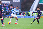 Juninho Bacuna of Huddersfield Town (7) takes on Lucas Torreira of Arsenal (11) during the Premier League match between Huddersfield Town and Arsenal at the John Smiths Stadium, Huddersfield, England on 9 February 2019.